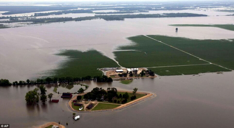 Floodwater from the Yazoo river creeps across fields of crops
