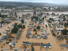 Floodwaters surround houses Tuesday in Centralia, Washington