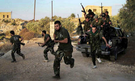 Free Syrian Army soldiers run for cover in Idlib province N Syria