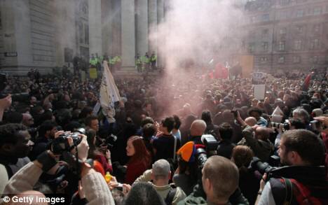 Furious demonstrators let off smoke bombs