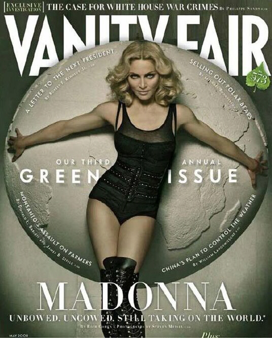 Madonna appears on the green cover of Vanity Fair, holding the entire world