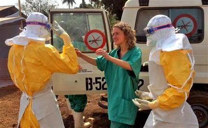 Healthcare workers prepare victim for isolation and treatment for Ebola