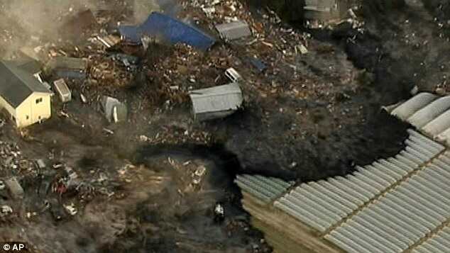 Houses in Sendai are washed away by the tsunami