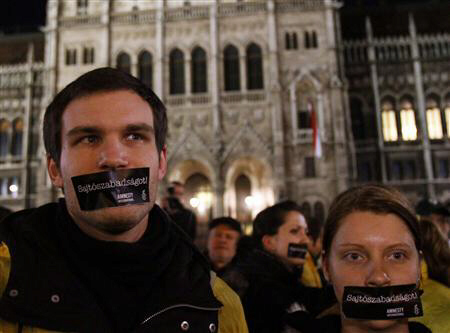Hungarians, with stickers on their mouth