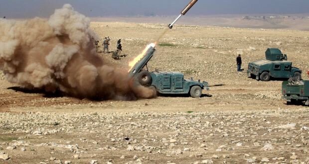 Iraqi rapid response forces fire a missile toward Islamic State militants