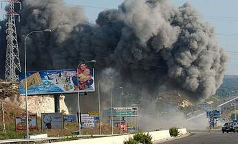 Smoke rises Wednesday after an Israeli airstrike on a bridge in southern Lebanon.