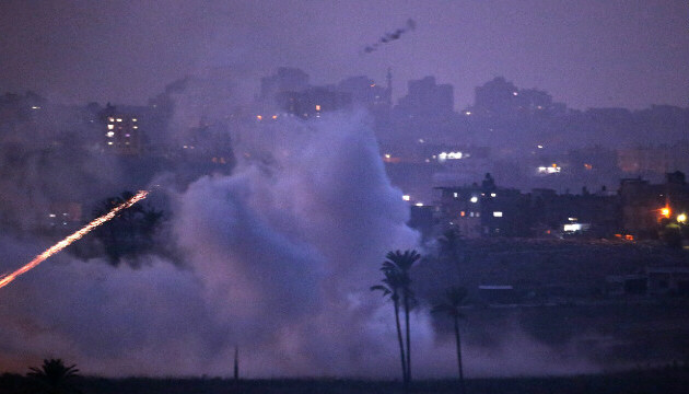 Israeli artillery shells hit a target in the Gaza Strip