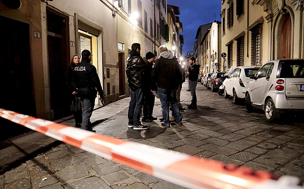 Italian police officers stand outside an apartment where American socialite Ashley Oslen, 35, was found dead in Florence
