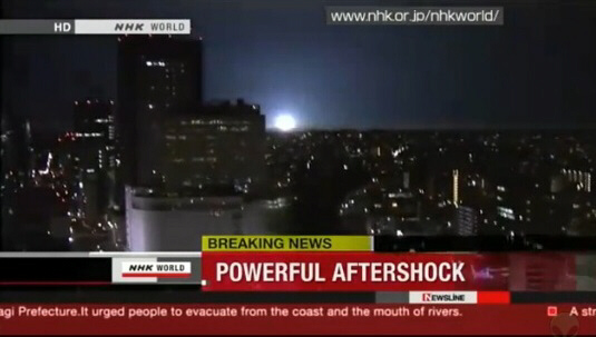 7.4 magnitude quake rocks Japan on April 7, 2011, causing skyscrapers to sway, accompanied by a strange blue fireball of light on the horizon