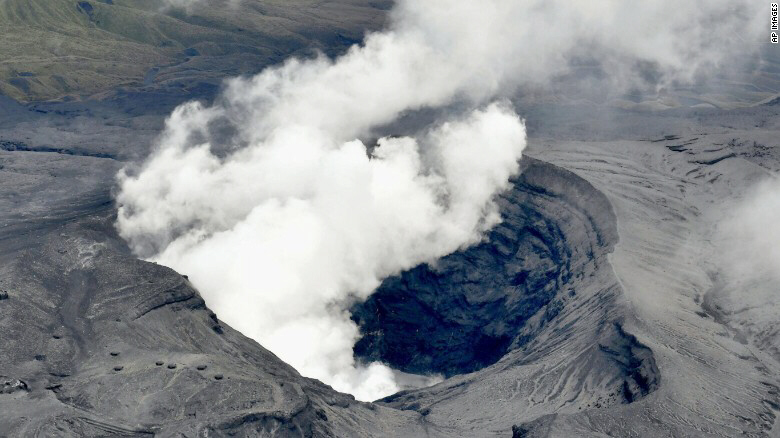 Japan's Mount Aso volcano sends a plume of ash into the air