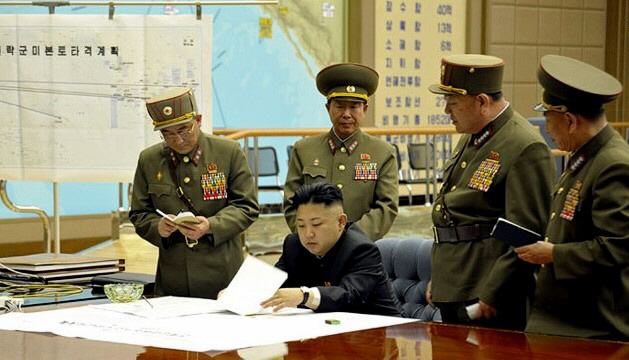 Kim Jong Un is briefed by his generals