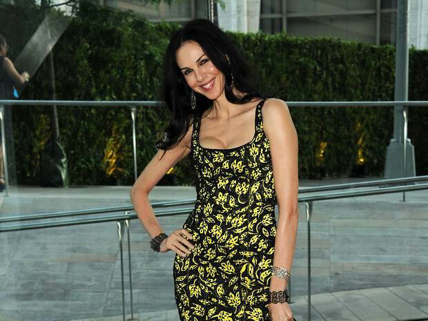 Model and fashion designer L'Wren Scott commits suicide at age 49