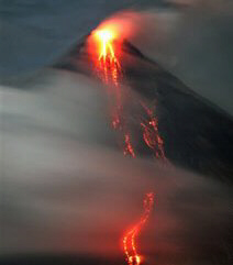 Lava cascades down the slopes of Mayon volcano