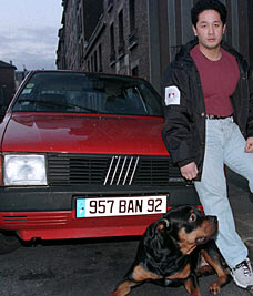 Was he there?: Le Van Tianh, his rottweiller and the Fiat Uno he resprayed just hours after the crash that killed Diana.