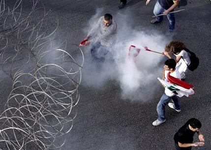 Lebanese protesters are enveloped in tear gas