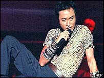 Leslie Cheung is reported to have committed suicide by leaping from a tall building with a single bound