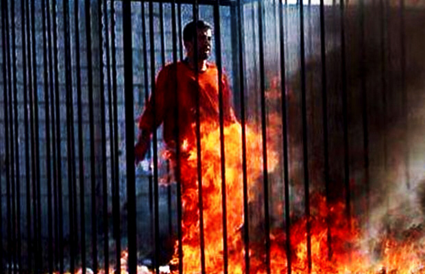 Jordanian air force pilot Maaz al-Kassasbeh is filmed by ISIS being burnt alive while locked in a cage