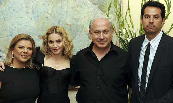 Madonna poses with PM Benjamin Netanyahu, his wife Sara, and Madonna bodyguard