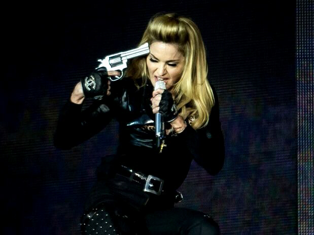 Madonna holds gun to head in ultimate display of frustration