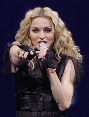 "Madonna declares war on Guy Ritchie and ""emotionally retarded"" people involved in long-distance relationships. Ritchie claims the pop diva is obsessed with spirit channeling and being a ""soothsayer"" for the world's masses."