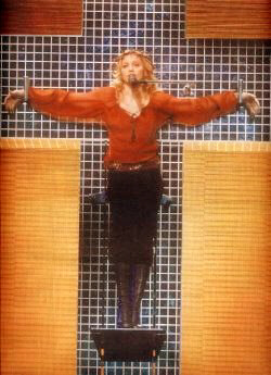 Madonna portarys herself as Jesus Christ hanging from cross