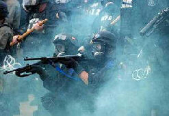 Conflict between police and rioters as martial law is imposed