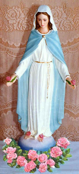 Statue of Mary with garland of roses at her feet