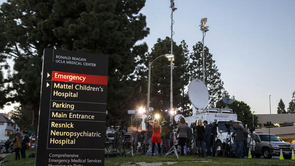 Media gather outside the Ronald Reagan UCLA Medical Center