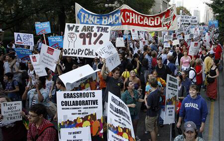 Members of a coalition called 'Stand up Chicago' march during a protest