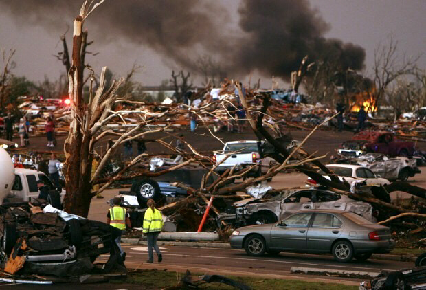 May 22, 2011 -- Emergency personnel walk through a neighborhood severely damaged by a tornado near the Joplin Regional Medical Center in Joplin, Mo. (AP Photo/Mark Schiefelbein)