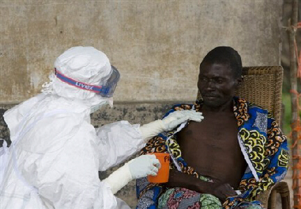 Nurse comforts 43 year old patient confirmed to have Ebola