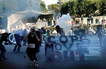 Oakland police deploy smoke and tear gas to stop protesters