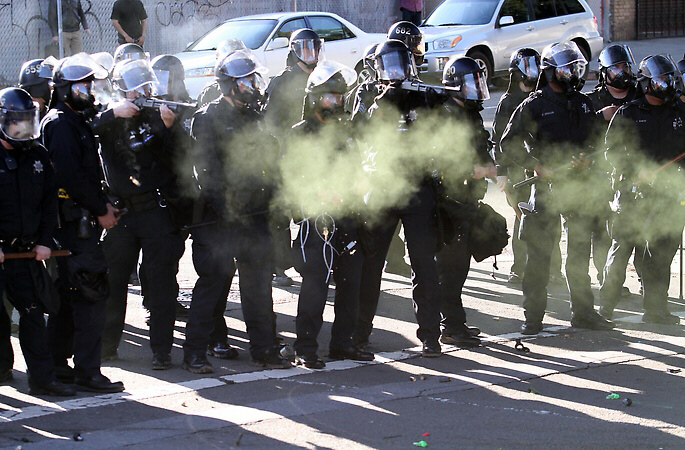 Oakland police fire tear gas, flash bang grenades and other projectiles