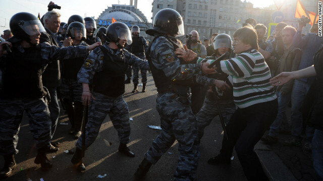 Opposition supporters clash with riot police