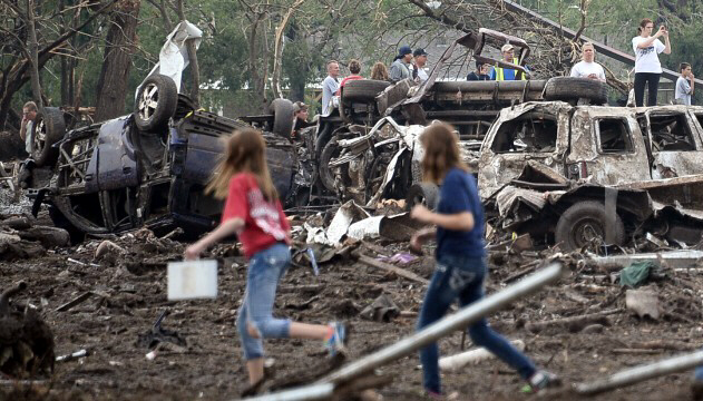 People look through the wreckage of their neighborhood