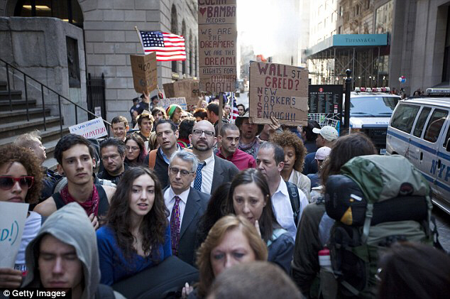 Blocking the streets: People protesting the economic system flood financial district sidewalks as office workers head to work on Monday.