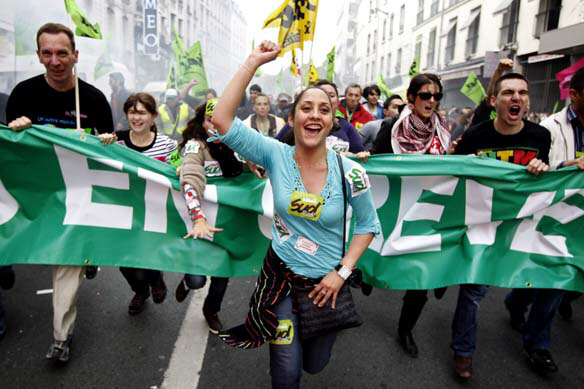 People run during a demonstration in Paris on Saturday as they pressure President Nicolas Sarkozy to drop plans to raise the minimum retirement age to 62 from 60. (Laurent Cipriani/Associated Press)