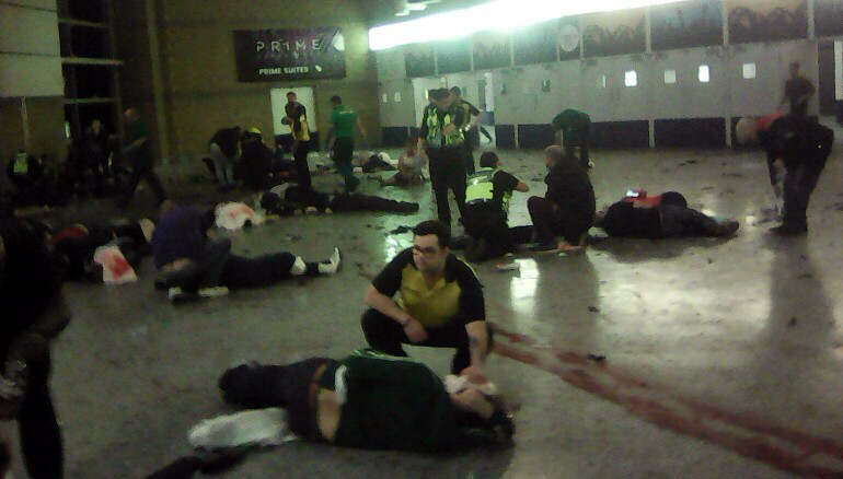 People tend to the injured inside the Manchester Arena