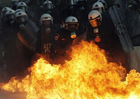 Petrol bomb explodes near riot police during demonstrations in Athens