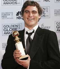 A gleeful Joaquin Phoenix wins a best supporting actor Golden Globe award for his role as the crazed, cruel, and comical Roman emperor 'Commodus' in Ridley Scott's 1999 epic, Gladiator (pronounced 'Glad-he-ate-her' ... and does he ever look glad).