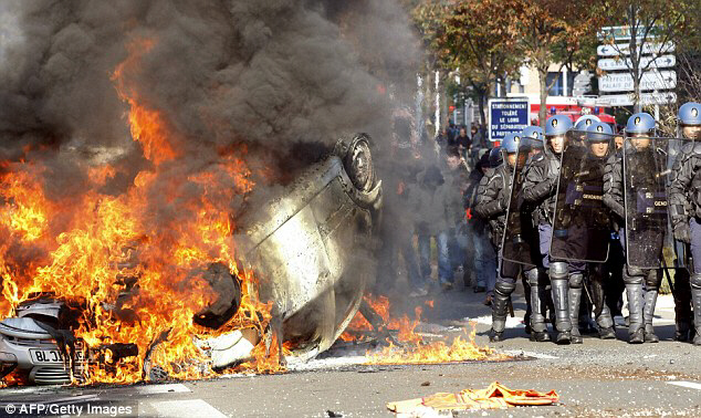 Police officers clash with rioters in Nanterre, north-west of Paris