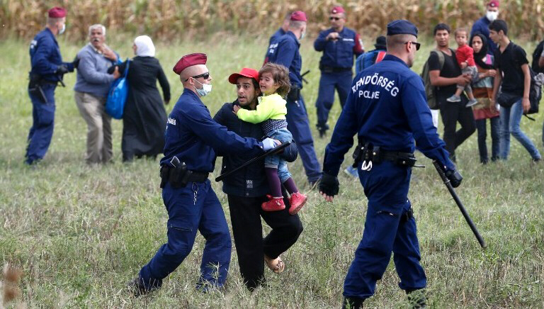Police stop migrants from leaving cordoned-off zone in Hungary