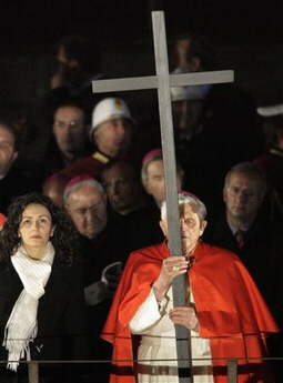 Pope Benedict XVI holds a cross