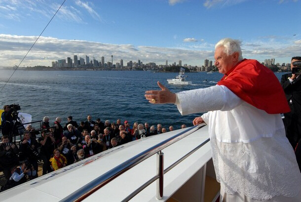 Pope Benedict XVI waves to the faithful from his ship
