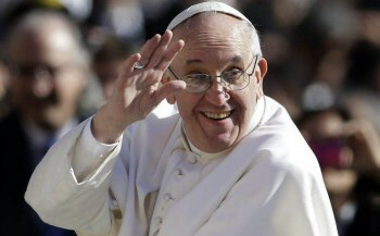 Pope Francis waves to crowds as he arrives to his inauguration Mass