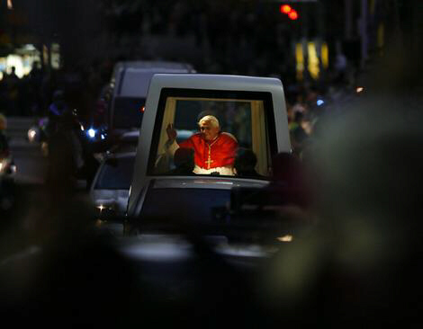 Pope Benedict XVI waves from his popemobile