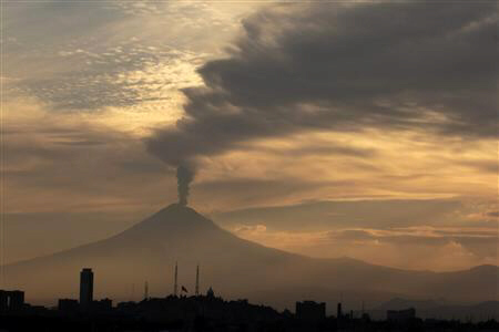 Popocatepetl volcano spews out huge clouds of ash and fiery rock