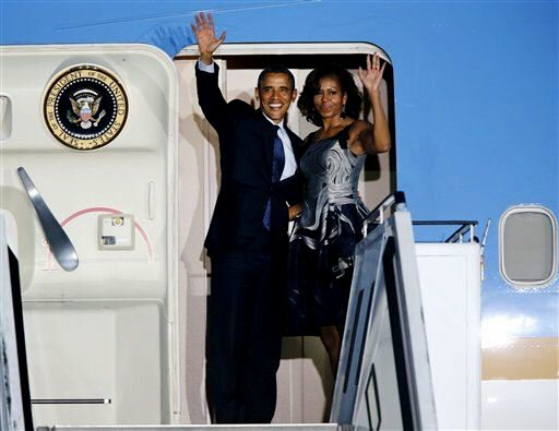 President Obama and first lady Michelle Obama wave goodbye.  Obama is to visit South Africa at the same time Neslon Mandela may die.  Could the Seer van Rensburg have seen both black leaders as one man ... will both die, Obama violently by an assassin???