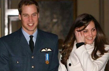 Prince William smiles as he walks with girlfriend Kate Middleton