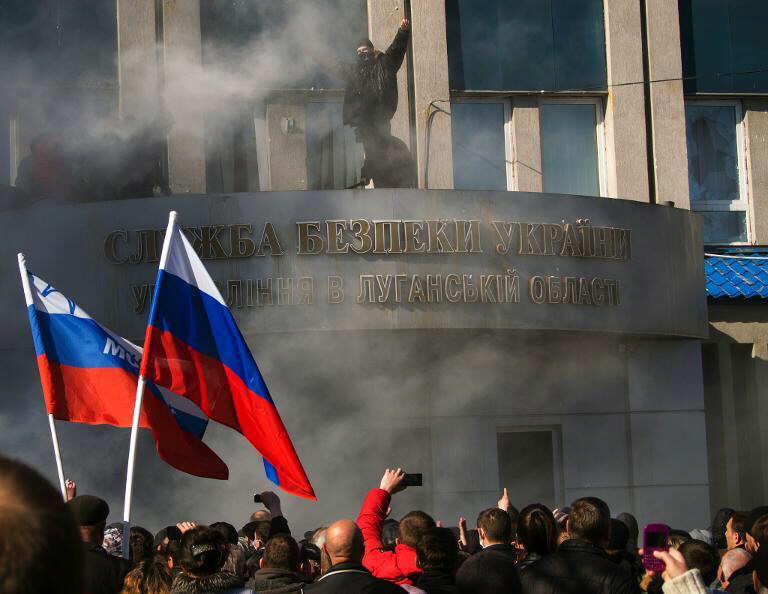 Pro-Russian activists hold a rally in Lugansk, Ukraine